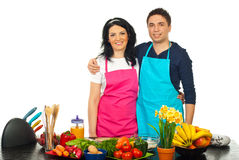 Hugging couple in kitchen Stock Image