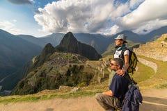 Hugging couple looking at Machu Picchu, Peru, toned image Royalty Free Stock Images
