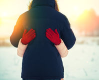 Hugging couple in love outdoors in winter Stock Photography