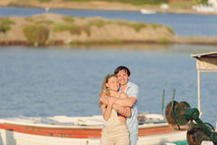 Hugging Couple on Pier Royalty Free Stock Image