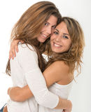 Hugging friends. Two young female friends hugging with happy expressions Stock Photos