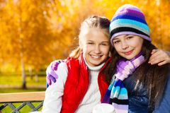 Hugging girls best friends Stock Photos