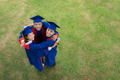 Hugging graduates Royalty Free Stock Photography