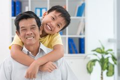 Hugging grandfather Stock Photography