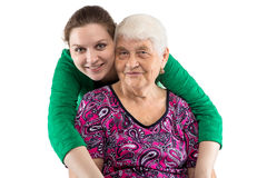Hugging grandma and granddaughter. Family on white background Royalty Free Stock Images
