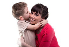 Hugging happy woman and her child. Hugging happy women and her child on white background stock photo