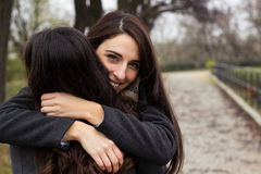 Hugging her best friend Royalty Free Stock Photos