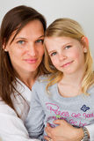 Hugging her daughter Royalty Free Stock Photography