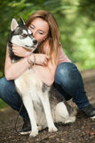 Hugging with her dog Royalty Free Stock Photo