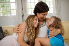 Hugging lovely daughters Stock Photo