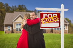 Hugging Mixed Race Couple, House, Sold Real Estate Sign Royalty Free Stock Image