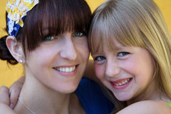 Hugging mother and daughter. Smiling mother and daughter share a hug Royalty Free Stock Photo