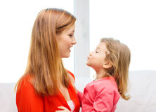 Hugging mother and daughter Stock Photography