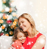 Hugging mother and daughter Stock Photo