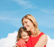 Hugging mother and daughter Royalty Free Stock Photo