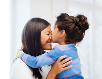 Hugging mother and daughter Stock Images