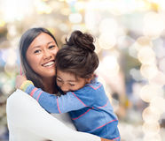 Hugging mother and daughter Stock Photos