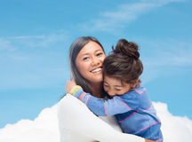 Hugging mother and daughter Royalty Free Stock Image