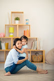 Hugging mother and daughter Stock Image