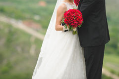 Hugging Newlyweds with Peony Bouquet Royalty Free Stock Photo