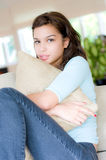 Hugging a Pillow. A lifestyle shot of a beautiful young woman holding a pillow Royalty Free Stock Image