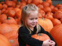 Hugging the Pumpkin. A cute little girl hugs her pumpkin from the pumpkin patch Royalty Free Stock Photo