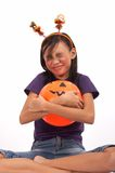 Hugging a pumpkin Royalty Free Stock Images