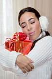 Hugging a red gift box Royalty Free Stock Images