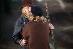 Hugging rustic couple Stock Photos