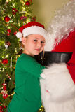 Hugging santa claus Royalty Free Stock Photos
