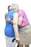 Hugging a senior. Volunteer or relative hugging a senior Royalty Free Stock Photography