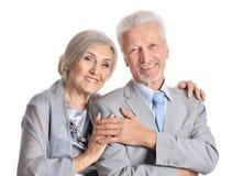 Hugging senior couple on white background Royalty Free Stock Image