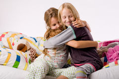 Hugging sisters Stock Images
