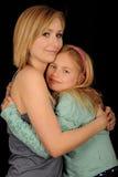 Hugging Sisters Stock Image