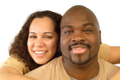 Hugging and smiling. Couple hugging and smiling in a close-up portrait shot on white Royalty Free Stock Image