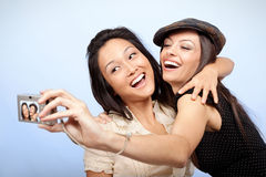 Hugging and taking pictures Royalty Free Stock Images