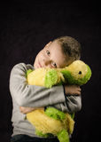 Hugging a toy Royalty Free Stock Photography