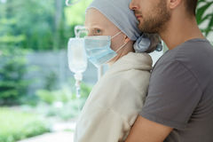 Hugging wife with malignant cancer Stock Images