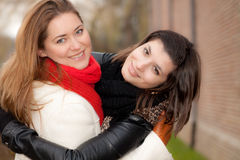 Hugging women Stock Image