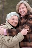 Hugging women Stock Images