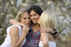 Hugging young female friends Royalty Free Stock Images