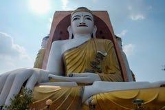 Hugh buddha statue. Enormus buddha statue in Myanmar and myanmese come to pray and worship Stock Photography