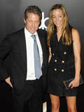Hugh Grant and Anna Elisabet Eberstein Stock Images