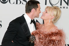 Hugh Jackman and Deborra-Lee Furness. Australian Hugh Jackman is poised to kiss wife Deborra-Lee Furness, likewise from Oz as they celebrate his special award at Royalty Free Stock Photos