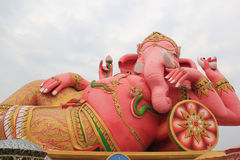 Hugh Pink Genesha, the elephant-deity riding a mouse, one of the. Commonest mnemonics for anything associated with Hinduism, located at Wat Samanrattanaram Stock Photo
