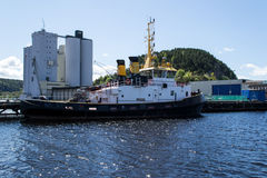 Hugin Tugboat. Hugin is a tugboat used in the harbor of Halden. It is used to help large cargo ships to turn after beeing docked Royalty Free Stock Images