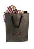 Hugo Boss Black Shopping Bag con i contenuti sopra Immagini Stock Libere da Diritti