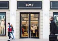 Hugo Boss entrance. Vilnius, Lithuania - May 03, 2016: View of Hugo Boss luxury fashion house store entrance with brand signage in Vilnius, Lithuania Stock Images