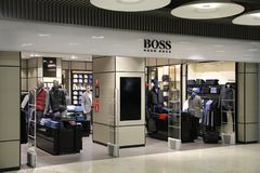 Hugo Boss store. MADRID, SPAIN - OCTOBER 20, 2014: Hugo Boss fashion store at Madrid Barajas Airport T4. There are 63 shops in airport's Terminal 4 stock photo