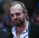 Hugo Weaving poses on the red carpet Stock Images